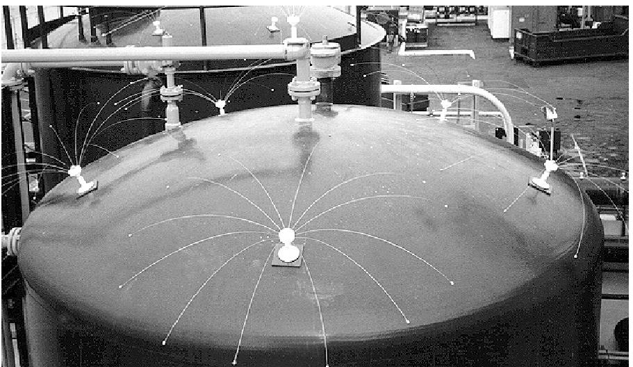 """The spider-like devices on the top of this tank are called """"Daddi Long Legs""""®. The steel rods move in the breeze, scaring birds away from landing on the tank. Scare devices that move are generally more effective than stationary objects."""